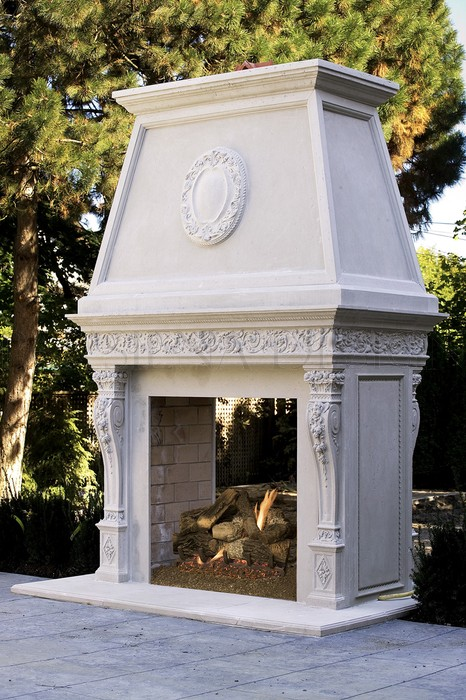 Exterior mantel beside a pool